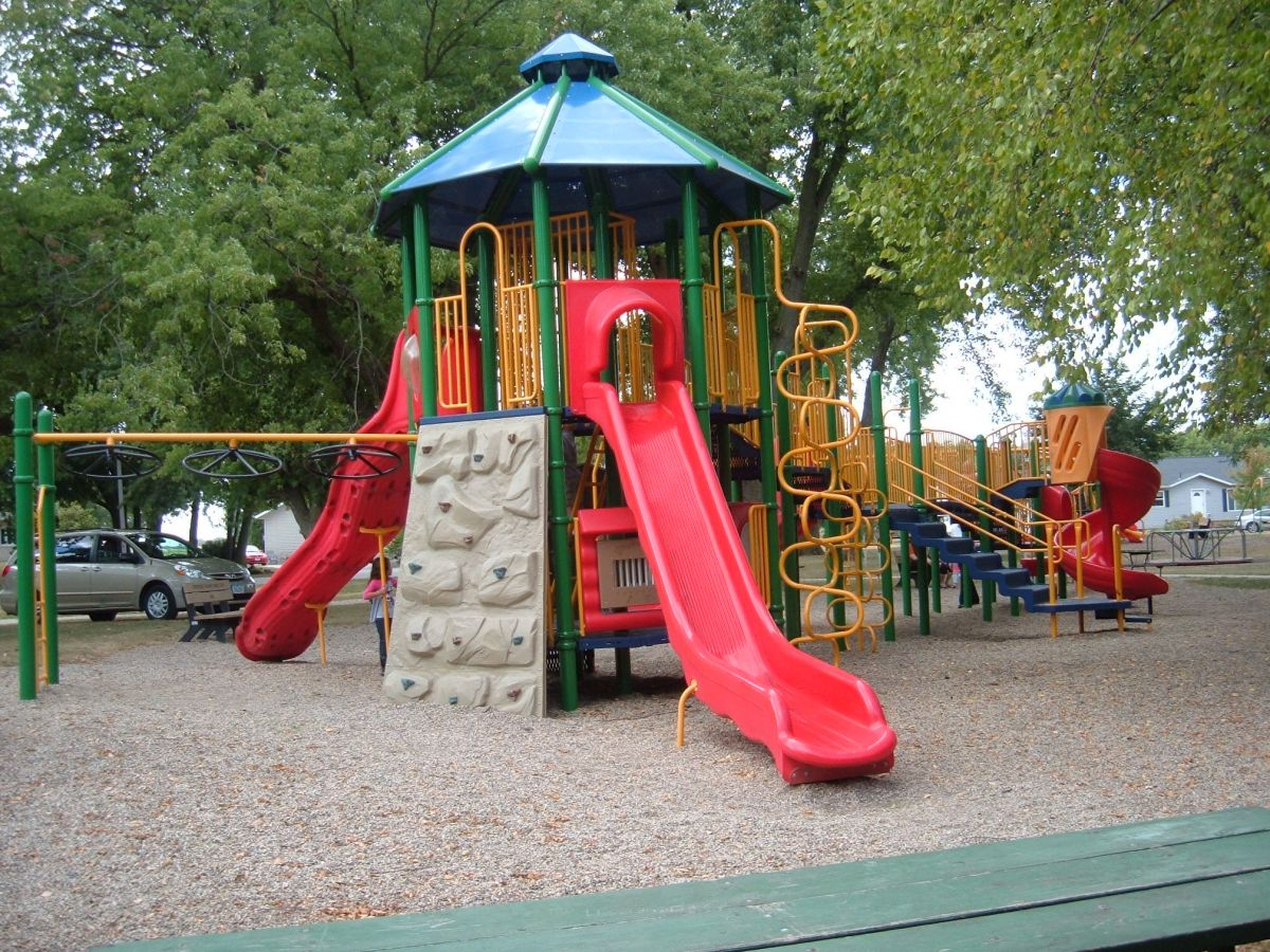 The city park has two playground areas for kids to utilize. There are also swings, a merry-go-round and a slide.